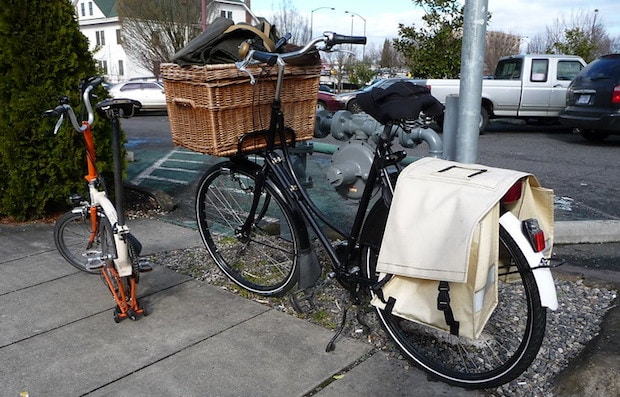 bicycle with basket on front and panniers on the back