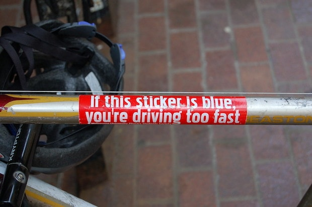 Sticker on a bike frame that says If This Sticker is Blue You're Driving Too Fast