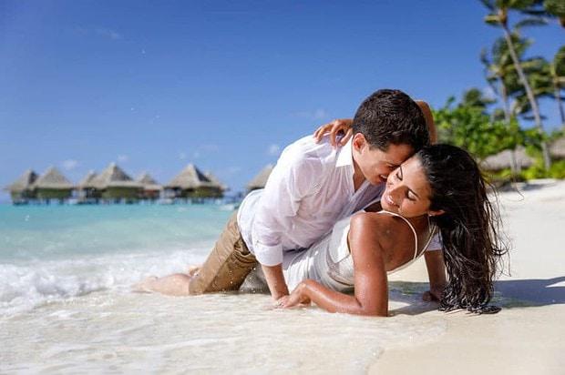 Livia & Marc lying on the beach of Bora Bora