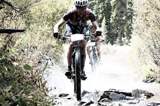 Mountain bikers on a rocky riverbed