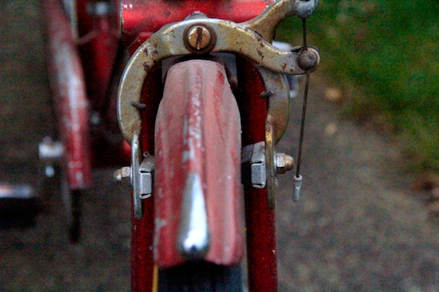 Caliper brakes on a very old red bike
