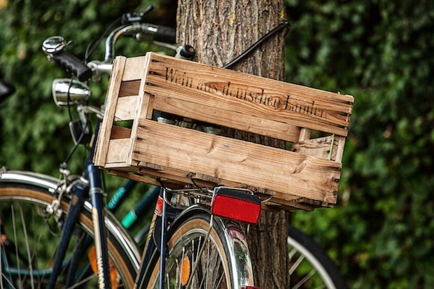 Large wooden crate mounted on the back of a bike