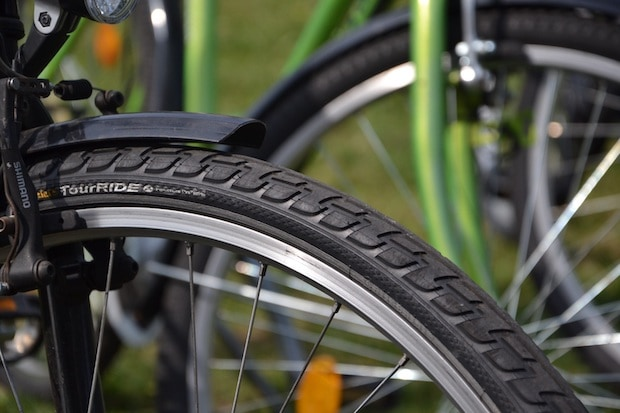tread of a bike tire showing the arrows pointing toward the front of the bike