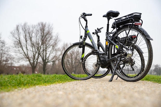 E-bikes parked with kickstands while on a tour