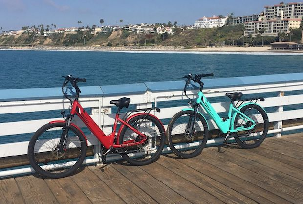 48 volt ebikes lean on the railing of a pier