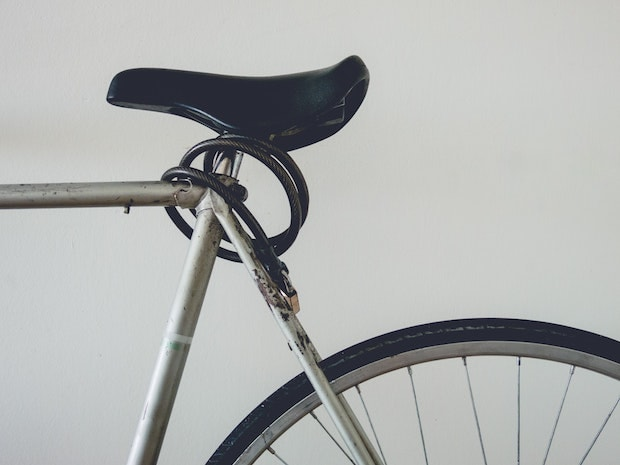 Cable lock wrapped around a bicycle seat post