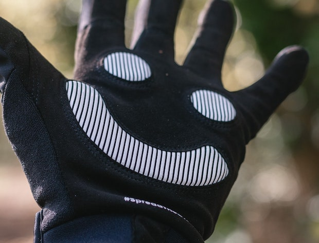 Palm of a cycling glove with padding in the shape of a happy face