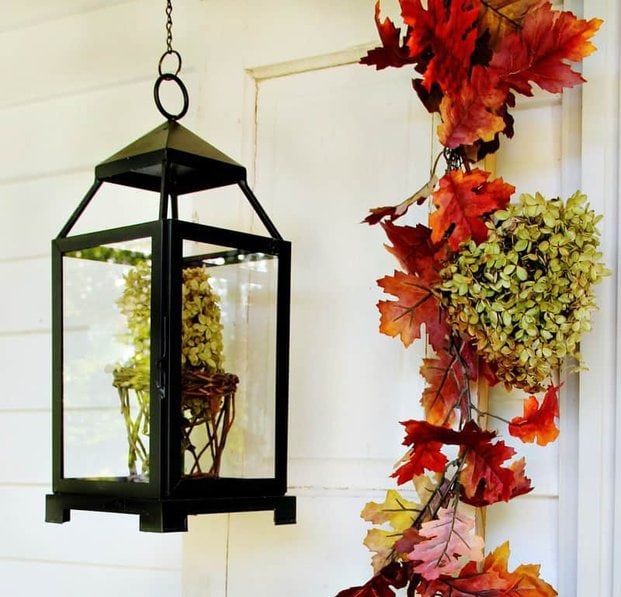 This lantern with hydrangeas inside is a fun decor piece for fall.