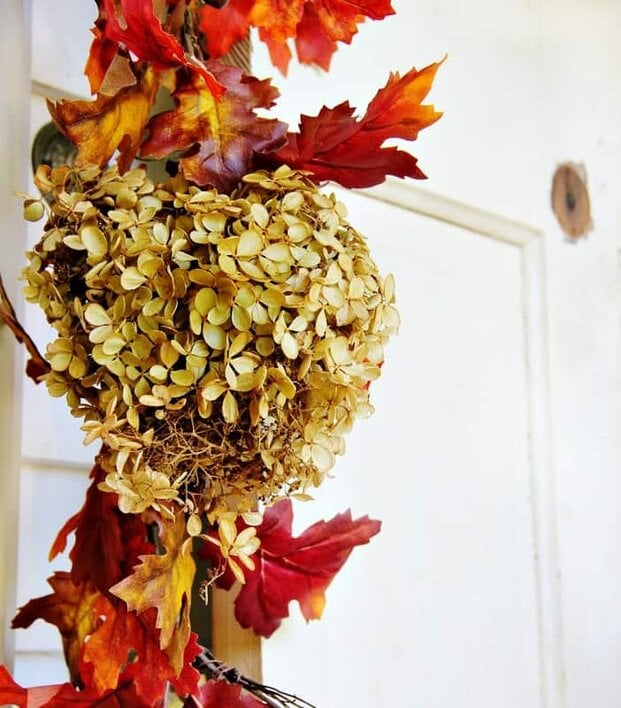 This fall colored garland from the dollar store is a budget friendly way to decorate your front door.