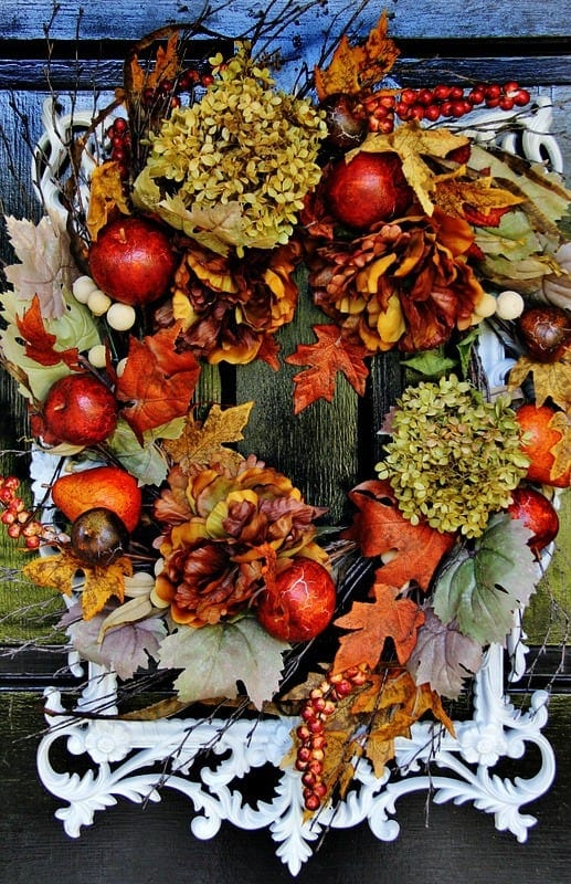 A fall wreath with a frame for your front door add a festive touch to your home.