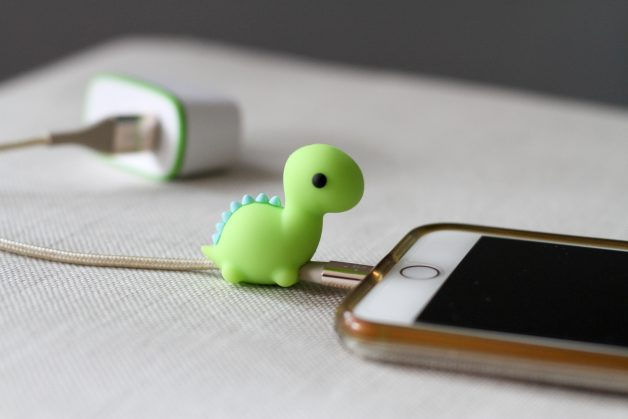 green dinosaur charging cable protector