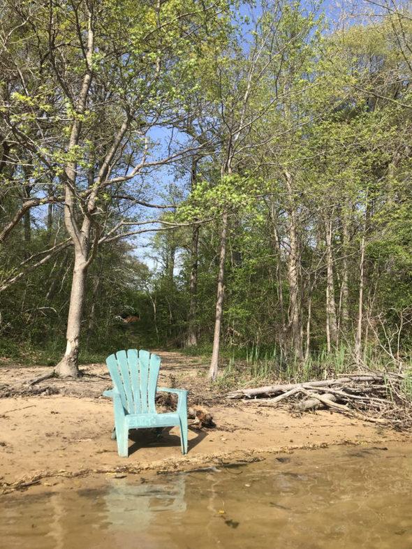 Adirondack chair on riverside.