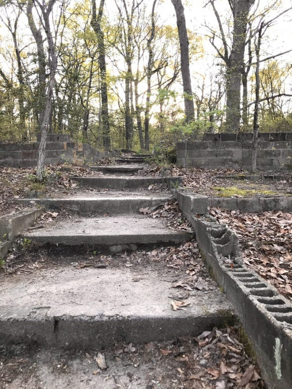 Broken-down cinder block stairway at a park.