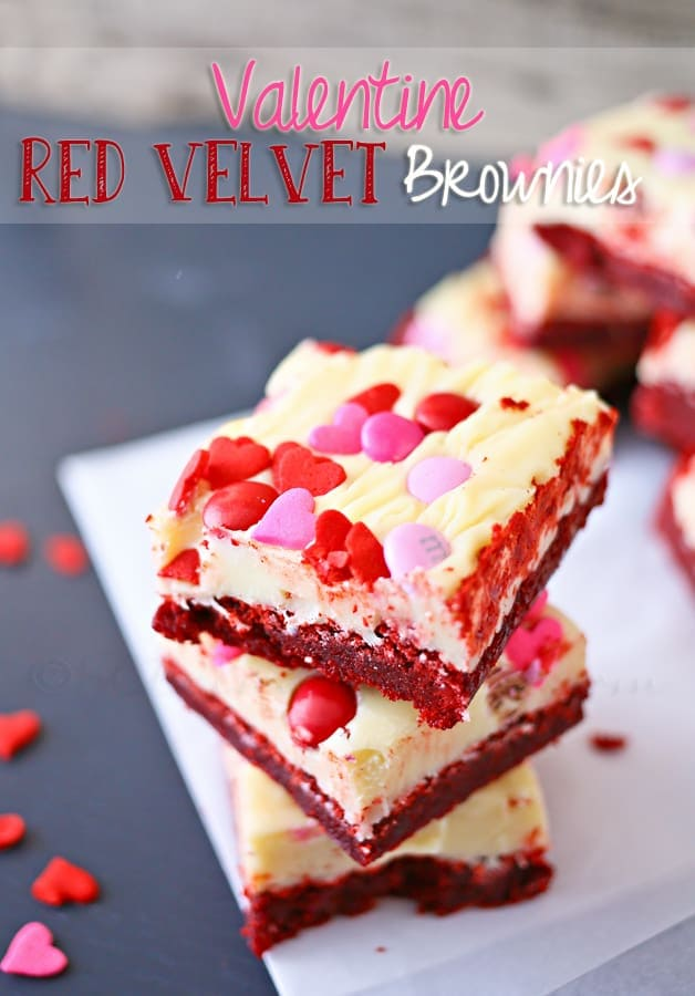 A stack of frosted red velvet brownies