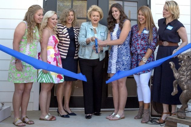 Alpha Delta Pi Sisters Sara Jane Bowers, from left, Cassidy Collier, Jan Maisch, international vice president of collegiate membership, Carole Ann Daniel, a Brenau Trustee and past Lambda President, Katelyn Brown, Maggie Griffin and Kelley Robertson, the Lambda Chapter's advisor, cut the ribbon on the Alpha Delta Pi sorority house during the Brenau University Alumnae Reunion Weekend on Saturday, April 16, 2016, in Gainesville, Ga. (AJ Reynolds/Brenau University)