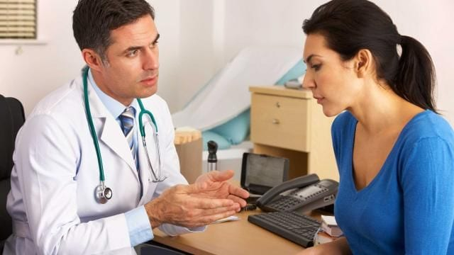 ADHD doctor speaking to a woman