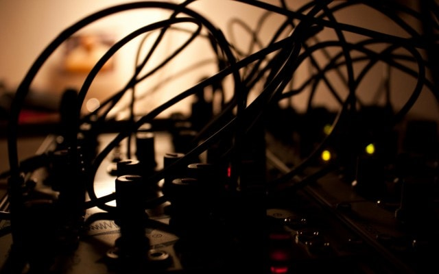 """Late at night, patching cables in Make Noise's brilliantly-named """"Maths"""" module. Photo (CC-BY) x2mirko - another German artist using American modules in the homeland of Eurorack."""
