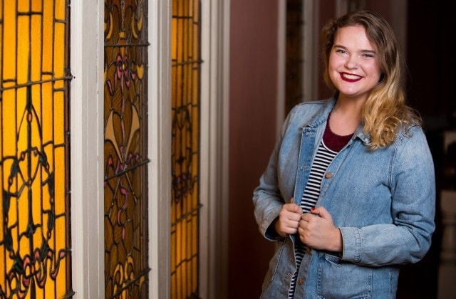 Hallie Storms, a freshman theater major poses for a photo in Pearce Auditorium. Storms is one of the Brenau Scholars. (AJ Reynolds/Brenau University)