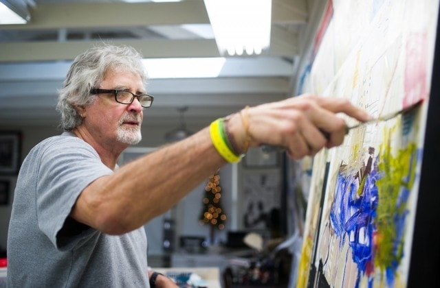 Dennis Campay paints in his studio in Jacksonville, Fla. (AJ Reynolds/Brenau University)