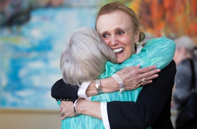 Paige Houseman, WC '66, gets a hug from Judy Davis Alexander, WC '67, before the dinner for the dinner for the 50th anniversary with the Brenau Trustees. (AJ Reynolds/Brenau University)