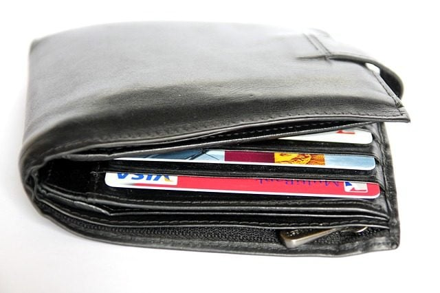 bulging wallet with cards