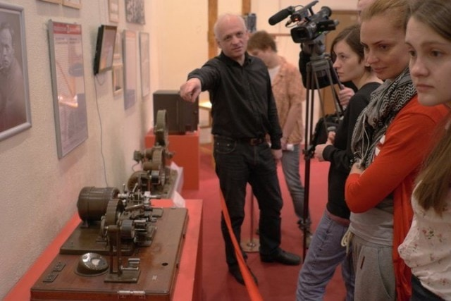 Andrey Smirnov takes visitors on a tour of his exhibition in Moscow.