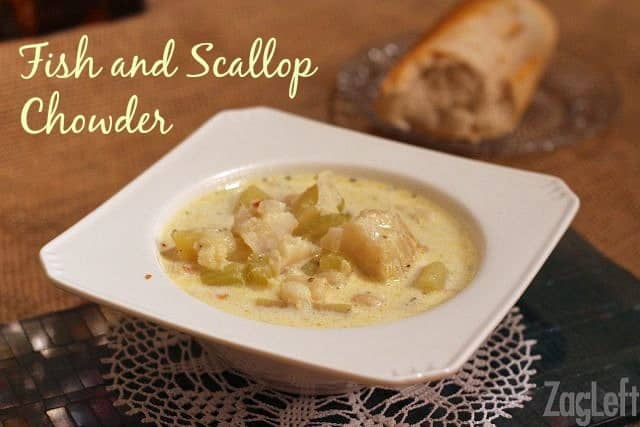 A bowl of Fish and Scallop Chowder on a doily next to a slice of french bread on a small plate