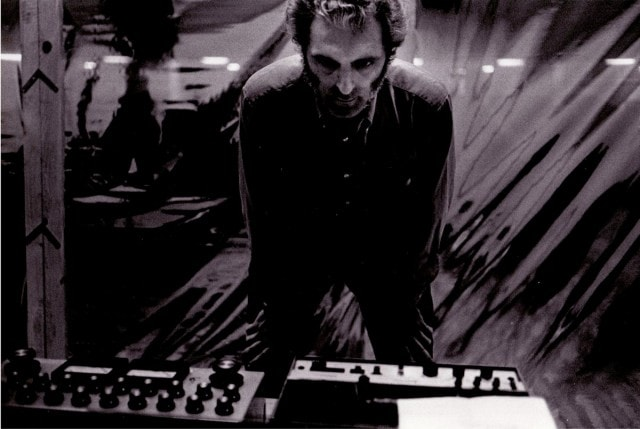 The synth innovator at work, as pictured in a photo from the collections of the Bob Moog Foundation.