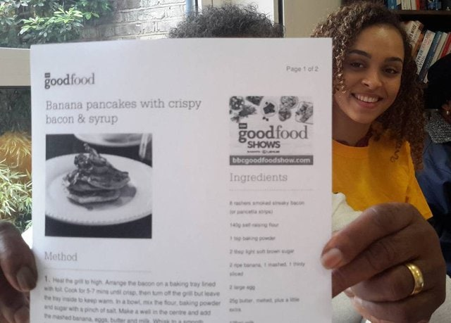 Unidentified person holds up a printed recipe