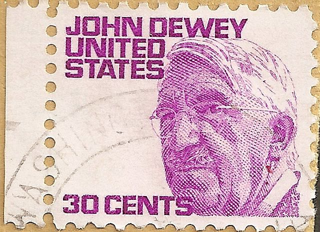 30-cents stamp of the USA figuring American philosopher John Dewey, issued 21 October 1968. Sourced from Wikimedia Commons and believed to be in the public domain. Scan of a personal item.