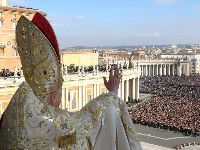 "In this photo released by the Vatican's L'Osservatore Romano newspaper, Pope Benedict XVI delivers his blessing to the faithful gathered in St. Peter's Square at the Vatican, from the velvet-draped loggia of St. Peter's Basilica, during the ""Urbi et Orbi"" message, Latin for ''to the city and to the world"", Tuesday, Dec. 25, 2007. The pontiff issued a Christmas Day appeal to political leaders around the globe to find the ""wisdom and courage'' to end bloody conflicts in Darfur, Iraq, Afghanistan and the Congo. (AP Photo/L'Osservatore Romano, HO)"