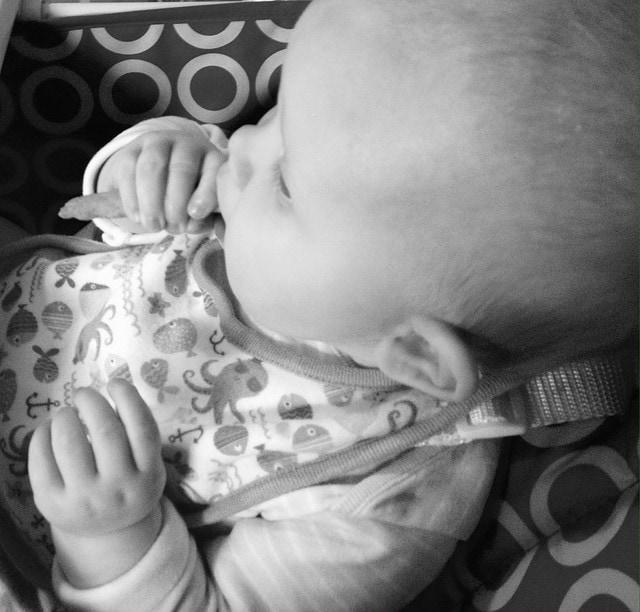 Baby girl enjoying her pumpkin and banana wafer wisp - Rachel Bustin