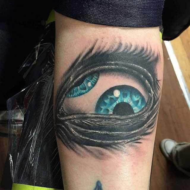 Глаз тату на предплечье