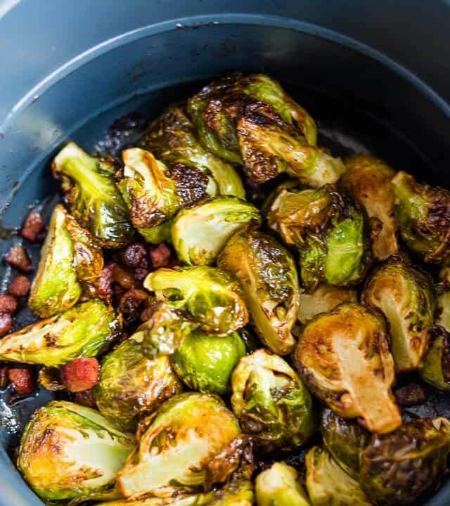 air fryer Brussels sprouts in the basket of the instant pot air fryer lid with pancetta