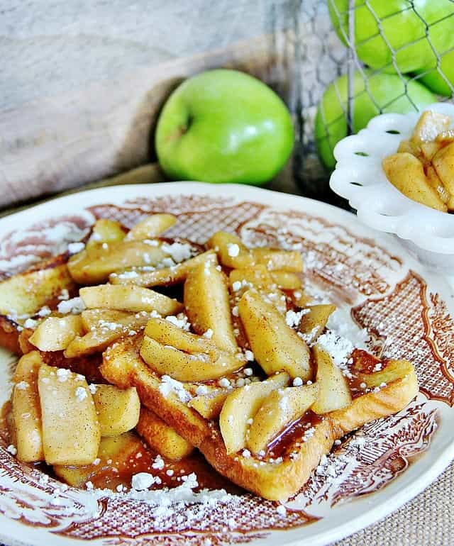 This delicious french toast recipe is dusted with powdered sugar and topped with sweet apples.