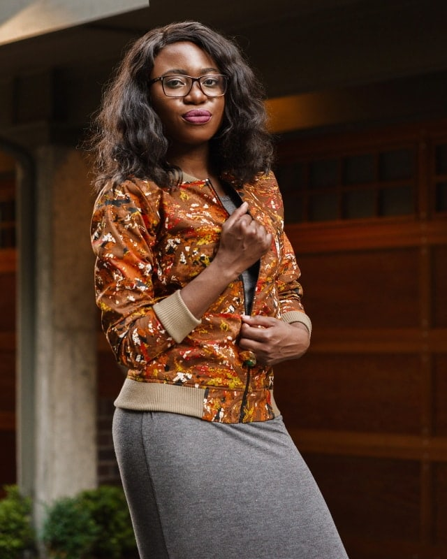 African Print Ankara Bomber Jacket | Fashion blogger styling a chic Ankara bomber jacket with a simple midi-length bodycon dress completed with black multi-strap sandals.