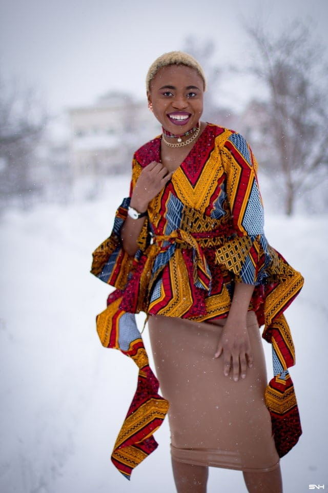 If you thought African print couldn't get better, you'd be surprised! Totally lusting on this handmade African print wrap blouse. The colors and style make a bold statement. Definitely not one for the faint of heart. Loving the contemporary twist with a jersey midi skirt and classic pumps. All that peplum detail got me obsessed! #ankara #africanprint #ankarafashion #nigerian