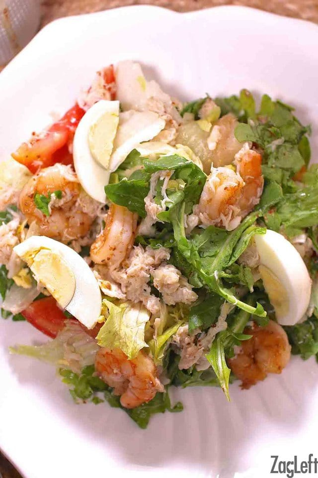 Shrimp and Crabmeat Salad made with lots of shrimp and crabmeat and topped with tomatoes, hard boiled eggs and a tangy Creole Vinaigrette | www.zagleft.com