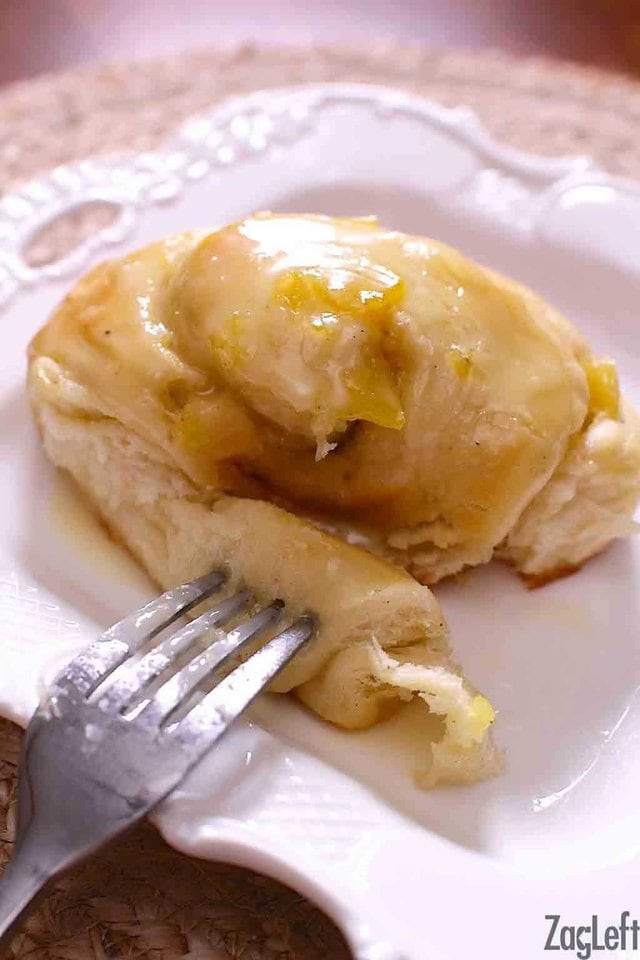 These soft Pineapple Sweet Rolls are my family's favorite breakfast treat. With a cardamom spiced pineapple filling and a sweet pineapple glaze, they're sure to be a hit at your home too. This big batch recipe is perfect for serving a crowd with directions for freezing to bake later too...