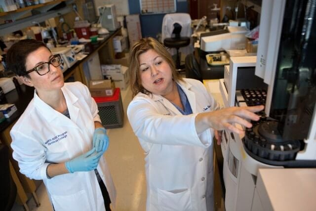 Dr. Dana Barr, right, and Rachel Golan, a post doctorate fellow, in a lab at Emory University.