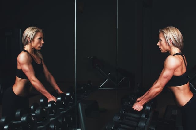 Woman and dumbbells