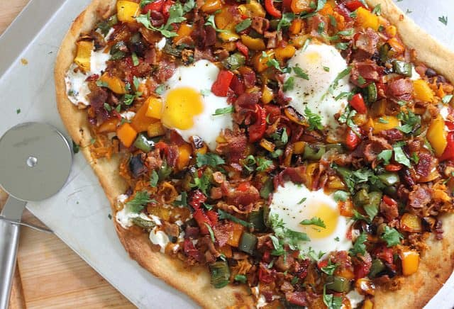 Breakfast pizza with bacon and eggs