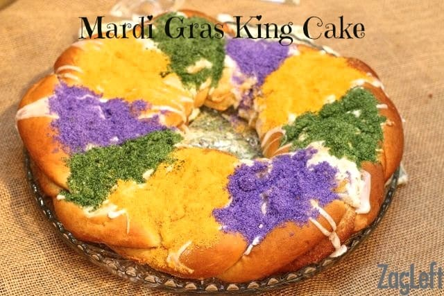 a king cake with icing and the colors f Mardi Gras; purple, green and gold