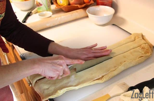 Cutting the folded dough into three strips