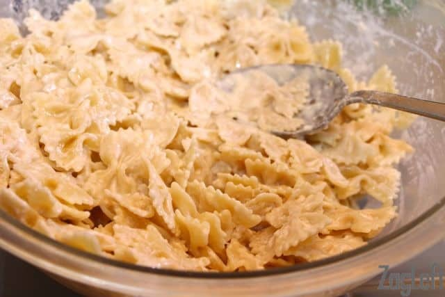 Egg, heavy cream, and water mixture mixed into the cooked pasta in a large mixing bowl
