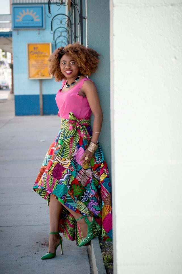 Slay mama! This African wax print high low skirt is irresistible! Everything about this skirt is classy and vibrant. ? Now I see why African print is all the rave. I need this patchwork beauty in my wardrobe. Ankara, Dutch wax, Kente, Kitenge, dashiki, ankara maxi skirt, African fashion, African clothing, African prints, Nigerian style, Ghanaian fashion, bomber jacket, Kenya fashion, Nigerian fashion