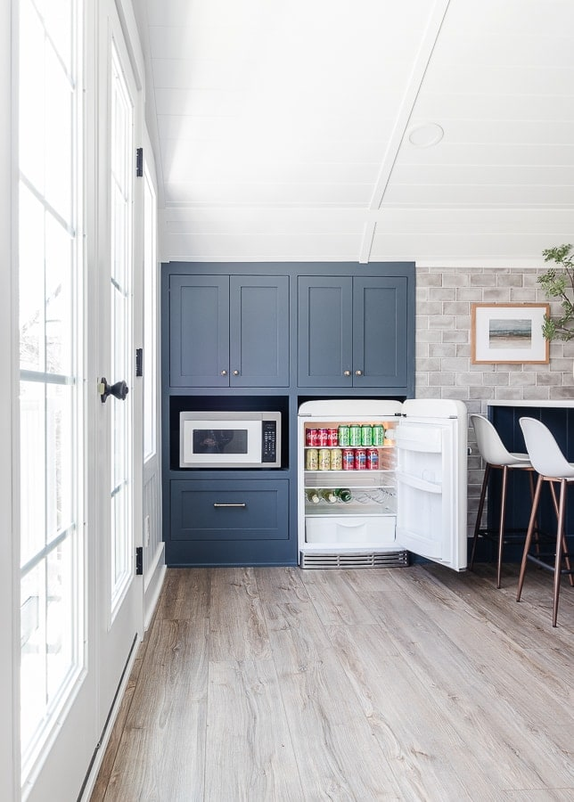 navy cabinets gray tile white chairs snack bar