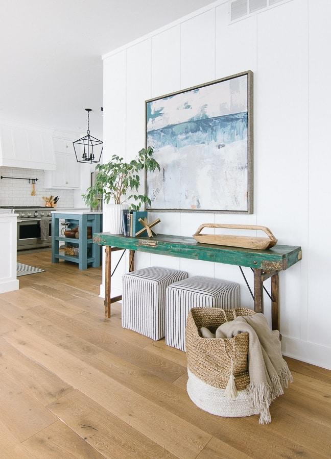 coastal console table striped ottomans