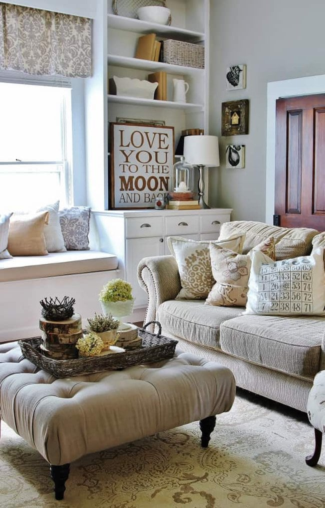 The wood centerpieces in this living room add a rustic element to this farmhouse living room.