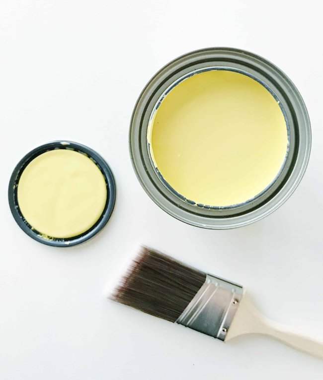 A light, pale yellow paint color from Sherwin-Williams called Overjoy SW 6689